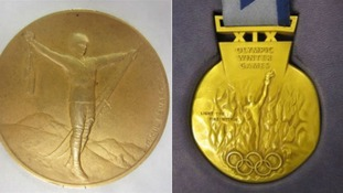 Curler Rhona Martin's Olympic gold medal which is among £34,000 worth of items stolen during a break-in at Dumfries museum.