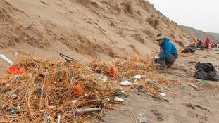 Rubbish that has been swirling around in the sea for decades was found on Britain's beaches in a Surfers Against Sewage clean-up.
