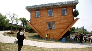 Tourists visited the upside down house in Fengjing Ancient Town, Jinshan District, south of Shanghai.