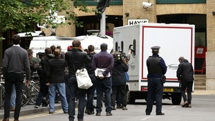 Photographers chase Max Clifford's van as it is taken to Wandsworth Prison.