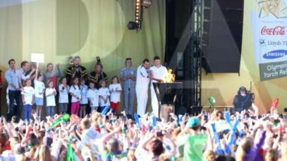 Craig Lundberg on stage with Olympic torch