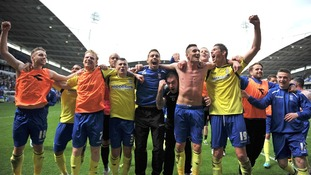 Players celebrate avoiding relegation