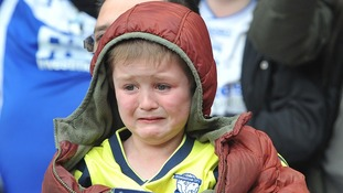 A Birmingham City fan is overcome with emotion