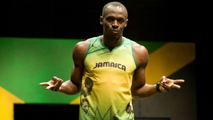 Jamaican sprinter Usain Bolt wearing the 2012 Jamaican Olympic kit during a photocall at Village Underground in London.