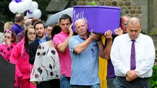 Hannah's father David (centre) carrying the coffin following her funeral last year.