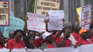 """Protesters sang """"bring back our girls"""" as they marched."""