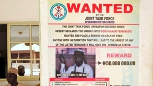 A wanted poster for Boko Haram leader Abubakar Shekau shown in May 2013.