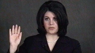 Monica Lewinsky shown being sworn-in during her videotaped deposition in President Clinton's impeachment trial.