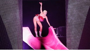 Former Hannah Montana star Miley Cyrus made an entrance by sliding down a replica of her own tongue.