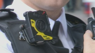 An officer wearing a bodycam video camera.