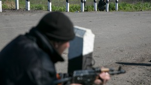 Armed pro-Russia men point their weapons at a checkpoint near the town of Slaviansk,eastern Ukraine