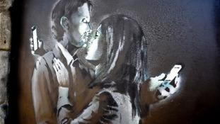 The Banksy artwork Mobile Lovers was removed from a wall in Bristol and taken to the youth club.
