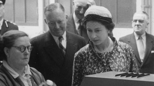 The Queen visiting a bottling plant in the early years of her reign