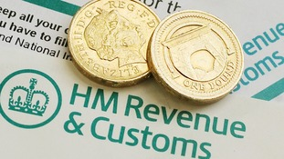 General view of pound coins on HM Revenue & Customs forms.