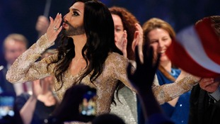 Conchita Wurst, representing Austria, reacts after qualifying.