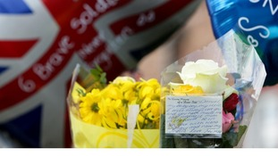 A note on flowers from Lisa Billing, mother of Private Daniel Wade outside the family home in Warrington.