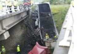Lorry crashes off M18 bridge