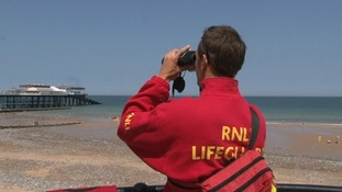 An RNLI lifeguard at Cromer beach