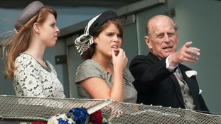 Princess Beatrice, Princess Eugenie and the Duke of Edinburgh, during the second day of the Epsom Derby horse racing festival