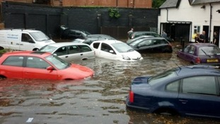 Cars left floating in a pub car park after the floods