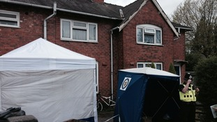 The house where their bodies were discovered