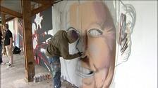 graffiti artist painting Queen