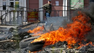 Tyres burn outside Mariupol's city hall after seven people died in clashes overnight