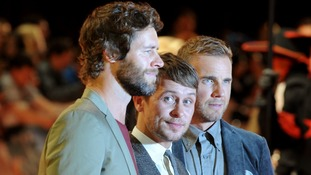 Take That singers Howard Donald, Gary Barlow and Mark Owen