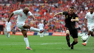 Jermaine Defoe came close but was denied by the frame of the goal