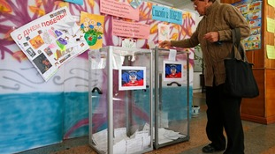 Votes are placed in clear boxes during open ballots.