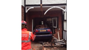 The car ended up in the house's hallway.