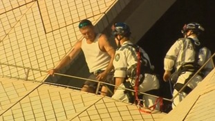 The man was fitted with a harness before being brought down from the sails.