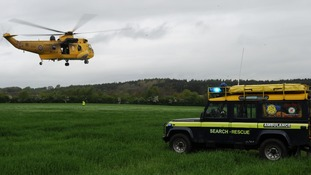 A Sea King helicopter has joined the search in Northumberland after three kayakers went missing