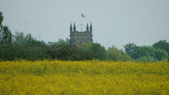 Church across field