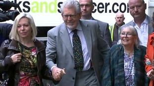 Rolf Harris (centre) arrives with his wife Alwen (right) and daughter Binki (left).