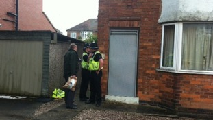 Police outside the boarded up house