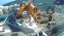 A decision was made to transfer one of the lifeboat crew to the yacht.