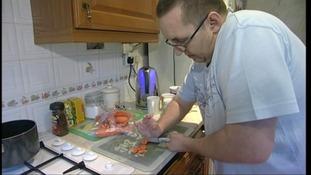 Man chopping veg