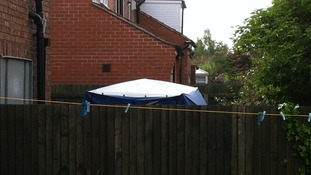 Forensic tent in the garden of a house on Burnholme Grove