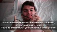 Stephen Sutton giving a thumbs up in his hospital bed.
