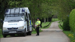 Police seen at Down Hall Country House in Essex last year.