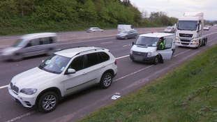 A wide shot of cars on motorway