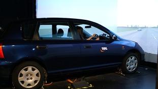 Woman driving simulator car