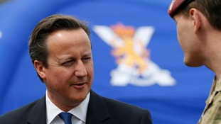 Prime Minister David Cameron meets members of the Armed Forces during his visit to the Walcheren Barracks in Glasgow.