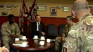 David Cameron speaks with soldiers during the first day of his visit to Scotland.