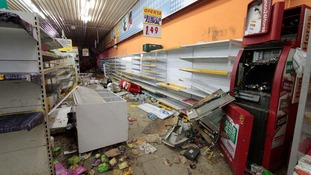 A looted shop in Brazil as protests erupt ahead of the World Cup.