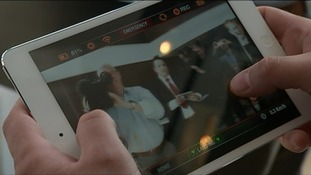 A tablet showing the cameraman filming the interview.