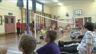 Suffolk students taught sitting volleyball