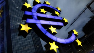 Euro sign in front of building