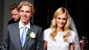 Model Poppy Delevingne and James Cook smile for the cameras after their wedding in Kensington.